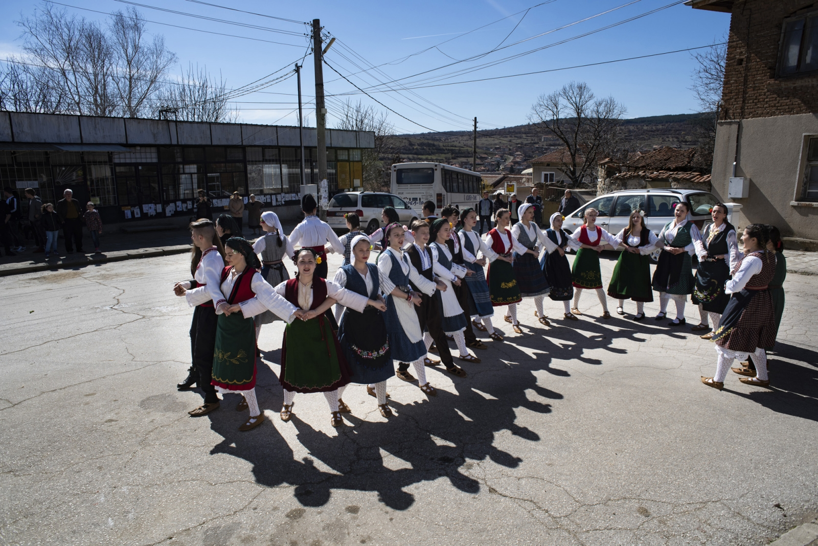 The Popintsi dance troop performs the horo before descending to the village square for the Sirnitsa celebrations in preparation for Lenten fasting. The village will nearly double in size, with people traveling from cities to visit aging relatives and participate in the festivities.